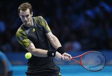 Britain's Andy Murray hits a return to Switzerland's Roger Federer during their men's singles semi-final tennis match at the ATP World Tour Finals at the O2 Arena in London November 11, 2012. REUTERS/Suzanne Plunkett