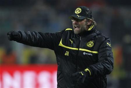 Borussia Dortmund's coach Juergen Klopp reacts during the German first division Bundesliga soccer match against Wolfsburg in Dortmund December 8, 2012. Wolfsburg won the match 3-2. REUTERS/Ina Fassbender
