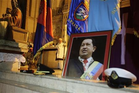 A priest holds a mass to pray for Venezuela's President Hugo Chavez in the Jesus de Miramar church in Havana, December 13, 2012. REUTERS/Desmond Boylan