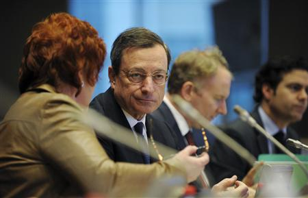 European Central Bank (ECB) President Mario Draghi (2nd L) addresses a news conference at the European parliament in Brussels December 17, 2012. REUTERS/Laurent Dubrule