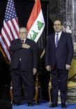 Iraqi Prime Minister Nouri al-Maliki (R) and Iraqi President Jalal Talabani stand for the national anthem during one of several planned ceremonies to mark the end of American military presence in Iraq, in Baghdad December 1, 2011. REUTERS/Khalid Mohammed/Pool (IRAQ - Tags: POLITICS MILITARY CONFLICT)