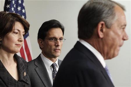 U.S. House Majority Leader Eric Cantor (R-VA) (C) looks on as Speaker John Boehner (R-OH) speaks during a news conference on the fiscal cliff, after a closed GOP meeting at Capitol Hill in Washington, December 5, 2012. REUTERS/Yuri Gripas