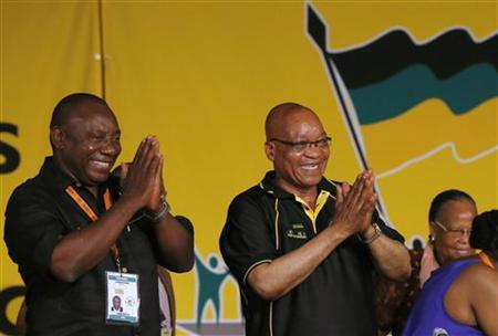 South Africa's President Jacob Zuma celebrates his re-election as party President alongside newly-elected party Deputy President Cyril Ramaphosa (L) at the National Conference of the ruling African National Congress (ANC) in Bloemfontein December 18, 2012. REUTERS/Mike Hutchings