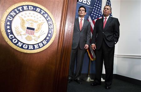 U.S. House Speaker John Boehner (R) (R-OH) and House Majority Leader Rep. Eric Cantor (R-VA) stand during a news conference after a Republican caucus meeting on Capitol Hill in Washington, December 18, 2012. REUTERS/Joshua Roberts