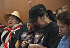 Supporters react during the Missing Women's Commission of Inquiry being made public in Vancouver, British Columbia December 17, 2012. REUTERS/Andy Clark