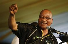 South Africa's President Jacob Zuma celebrates his re-election as Party President at the National Conference of the ruling African National Congress (ANC) in Bloemfontein December 18, 2012. South Africa's ruling ANC re-elected Zuma as its leader on Tuesday, setting him up for seven more years as head of state of Africa's biggest economy. REUTERS/Mike Hutchings