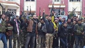 Free Syrian Army fighters from Al-Farooq battalion celebrate after the fighters said they fought and defeated government troops in Halfaya, near Hama December 18, 2012. REUTERS/Samer Al-Hamwi/Shaam News Network/Handout