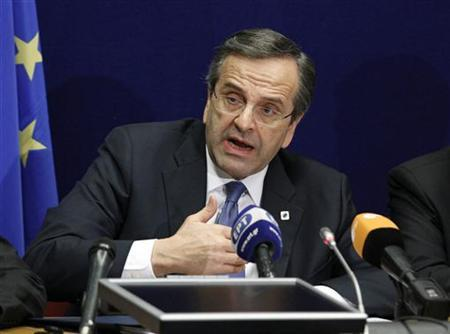 Greece's Prime Minister Antonis Samaras holds a news conference at the end of a European Union leaders summit in Brussels December 14, 2012. REUTERS/Sebastien Pirlet