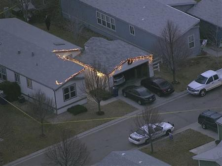 A police car sits in front of a home in Longmont, Weld County, Colorado, as pictured in this handout aerial image taken December 18, 2012, courtesy of thedenverchannel.com. A man shot and killed three people in the home in Colorado on Tuesday before turning the handgun on himself and committing suicide, authorities said. REUTERS/thedenverchannel.com/Handout