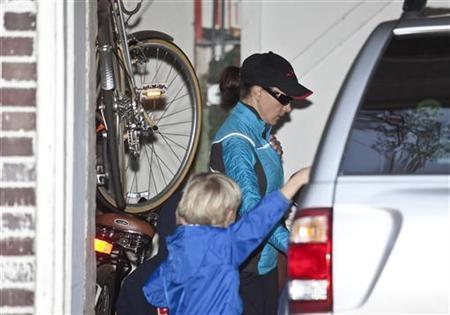 Paula Broadwell, the woman whose affair with former CIA chief David Petraeus led to his resignation, leaves her home in Charlotte, North Carolina November 20, 2012. REUTERS/John Adkisson/Files