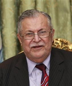 Iraq's President Jalal Talabani speaks to the media during a news conference in Baghdad in this November 23, 2010 file photo. REUTERS/Thaier al-Sudani/Files