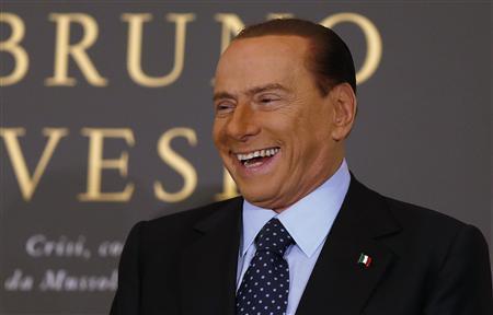 Former Italian Prime Minister Silvio Berlusconi smiles as he arrives to attend the book launch of his friend, TV presenter Bruno Vespa, in Rome December 12, 2012. REUTERS/Tony Gentile