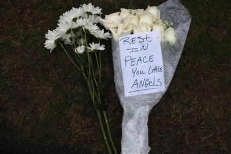 Flowers for the victims of the Sandy Hook Elementary School rest at a memorial in Newtown, Connecticut December 17, 2012. REUTERS/Joshua Lott