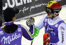 Marcel Hirscher of Austria (R), who won the race, celebrates with Naoki Yuasa of Japan, who placed third, after the men's World Cup slalom race in Madonna di Campiglio, northern Italy, December 18, 2012. REUTERS/Stefano Rellandini