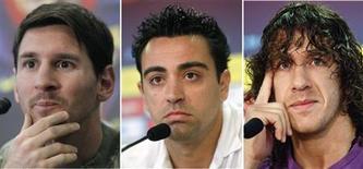 Le FC Barcelone va prolonger les contrats de Lionel Messi, Xavi et Carles Puyol (de gauche à droite), trois joueurs clés de l'équipe catalane. /Photo d'archives/REUTERS/Albert Gea