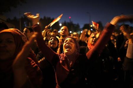 Protesters opposing Egypt's President Mohamed Mursi shout slogans as they demonstrate in front of the presidential palace in Cairo December 18, 2012. Opponents of Mursi staged protests in Cairo on Tuesday against an Islamist-backed draft constitution that has divided Egypt but looks set to be approved in the second half of a referendum this weekend. REUTERS/Khaled Abdullah
