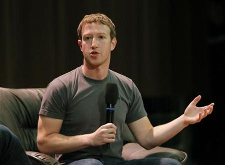 Facebook Chief Executive Mark Zuckerberg gestures as he addresses students at the Moscow State University in Moscow October 2, 2012. REUTERS/Maxim Shemetov/Files