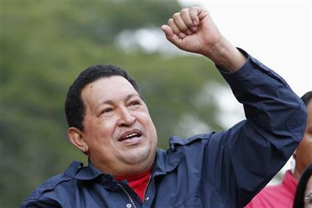 Venezuelan President and presidential candidate Hugo Chavez greets supporters during a campaign rally in the district of Catia in Caracas September 17, 2012. REUTERS/Jorge Silva
