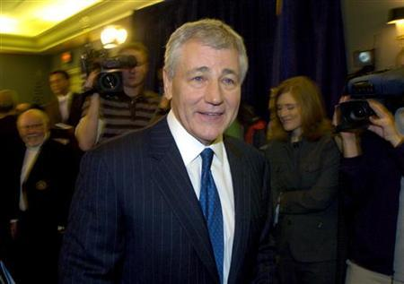 Chuck Hagel leaves a news conference in Omaha, Nebraska March 12, 2007. REUTERS/Dave Kaup