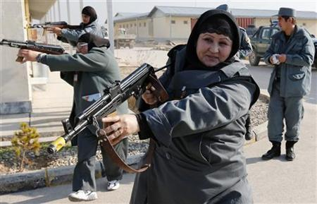 Female Afghan National Police (ANP) officers aim their weapons during a drill at a training centre near the German Bundeswehr army camp Marmal in Mazar-e-Sharif, northern Afghanistan December 11, 2012. REUTERS/Fabrizio Bensch