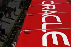Pedestrians walk past an Oracle tent during Oracle OpenWorld 2012 in San Francisco, California October 1, 2012. REUTERS/Stephen Lam (UNITED STATES - Tags: BUSINESS SCIENCE TECHNOLOGY)