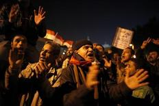 Protesters opposing Egypt's President Mohamed Mursi shout slogans as they demonstrate in front of the presidential palace in Cairo December 18, 2012. Opponents of Mursi staged protests in Cairo on Tuesday against an Islamist-backed draft constitution that has divided Egypt but looks set to be approved in the second half of a referendum this weekend. REUTERS/Khaled Abdullah (EGYPT - Tags: POLITICS CIVIL UNREST)