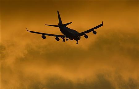 A British Airways jumbo plane flies in to land at Heathrow Airport in west London October 14, 2012. REUTERS/Toby Melville