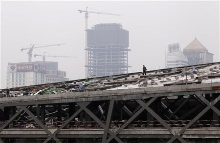 A labourer walks on the top of a construction site in Chengdu September 18, 2012. REUTERS/Jason Lee