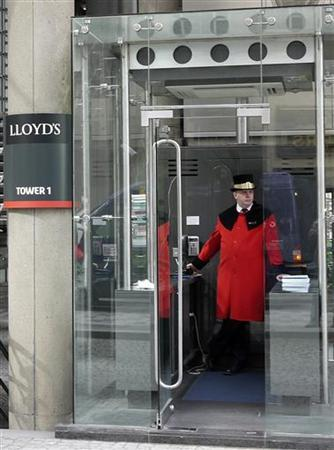 A doorman awaits limousines at the headquarters of Lloyd's of London, in the City of London May 13, 2011. REUTERS/Chris Helgren