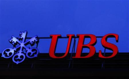 A logo of Swiss bank UBS is seen on a building in Zurich December 18, 2012. REUTERS/Michael Buholzer (SWITZERLAND - Tags: BUSINESS LOGO)