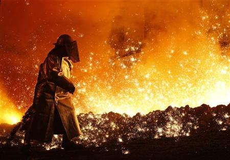 A worker controls the cast at a blast furnace of German steel manufacturer Salzgitter AG in Salzgitter March 24, 2010. REUTERS/Christian Charisius