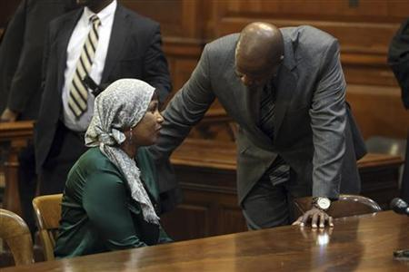 Hotel maid Nafissatou Diallo (L) speaks with her lawyer Kenneth Thompson in New York State Supreme Court during a hearing where a settlement in her civil lawsuit against former International Monetary Fund chief Dominique Strauss-Kahn was expected to be announced, in the Bronx, New York December 10, 2012. REUTERS/Seth Wenig/Pool