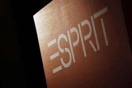 A company logo of Esprit is displayed during a news conference in Hong Kong September 15, 2011. REUTERS/Tyrone Siu