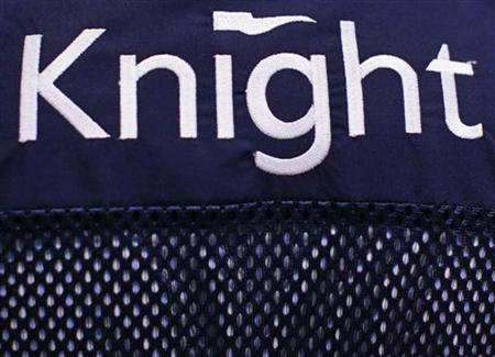 A Knight Capital logo is seen on a trader's jacket on the floor of the New York Stock Exchange August 1, 2012. REUTERS/Brendan McDermid