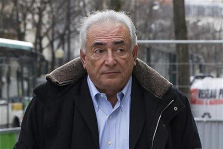 Former IMF head Dominique Strauss-Kahn gestures as he leaves his apartment in Paris December 10, 2012. REUTERS/Gonzalo Fuentes