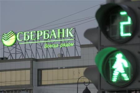 The Sberbank name is seen on a sign in a street in Russia's far eastern port of Vladivostok December 5, 2012. Message reads ''Sberbank. Always nearby''. REUTERS/Sergei Karpukhin