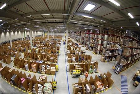 Work is carried out at Amazon's logistics centre in Graben near Augsburg December 17, 2012. Picture taken with a fisheye lens. REUTERS/Michael Dalder (GERMANY - Tags: BUSINESS)