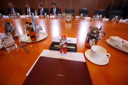 A chocolate Santa Claus stands on the table at the place of minister before the weekly cabinet meeting in Berlin December 6, 2012. REUTERS/Wolfgang Rattay (GERMANY - Tags: POLITICS)