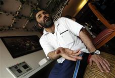 "Ahmed Abdul Khaleq, a stateless rights activist from UAE, speaks to Reuters during an interview in Bangkok after being deported to Thailand in this July 17, 2012 file photo. When Ahmed Abdul Khaleq started campaigning for the rights of his fellow stateless people in the United Arab Emirates, he was well aware he was risking something most activists were not - his home. After two months in jail for what he said was his human rights activism and campaigning for the stateless, he was given a choice: life in jail or deportation. Abdul Khaleq's expulsion is a rare measure taken against stateless residents in the UAE. But his story is indicative of the plight of all bidoon, an Arabic word meaning ""without"", tens of thousands without citizenship under strict nationality laws in the U.S.-allied Gulf Arab states, where citizens enjoy generous welfare benefits. To match Feature GULF-STATELESS/ REUTERS/Sukree Sukplang/Files"