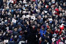 South Korea's presidential candidate Park Geun-hye (bottom C) of conservative and right wing ruling Saenuri Party waves to supporters during an election campaign rally in front of a railway station in Busan, about 420 km (261 miles) southeast of Seoul, December 18, 2012. REUTERS/Kim Hong-Ji