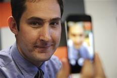 Kevin Systrom, Chief Executive of Instagram, the popular photo-sharing app now owned by Facebook, displays his photo on a mobile phone during an interview with Reuters December 4, 2012 at the LeWeb technology conference in Aubervilliers, near Paris. REUTERS/Philippe Wojazer