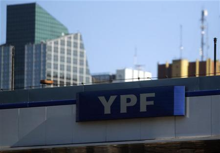 A YPF logo is seen outside a gas station near downtown Buenos Aires, April 12, 2012. REUTERS/Marcos Brindicci