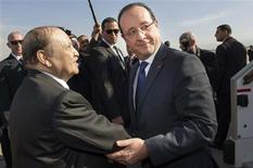 French President Francois Hollande (R) is welcomed by Algeria's President Abdelaziz Bouteflika upon his arrival at Algiers airport in Algiers December 19, 2012. REUTERS/Bertrand Langlois/Pool