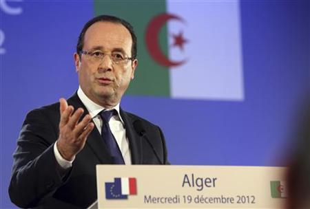 French President Francois Hollande speaks during a news conference in Algiers December 19, 2012 as part of the first day of his state visit to Algeria. REUTERS/Philippe Wojazer