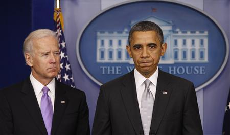 U.S. President Barack Obama, with Vice President Joe Biden (L) at his side, speaks to members of the media in the White House Briefing Room December 19, 2012. REUTERS/Kevin Lamarque