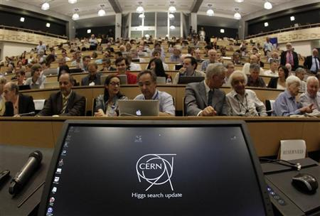 A computer screen is pictured before a scientific seminar to deliver the latest update in the search for the Higgs boson at the European Organization for Nuclear Research (CERN) in Meyrin, near Geneva July 4, 2012. REUTERS/Denis Balibouse