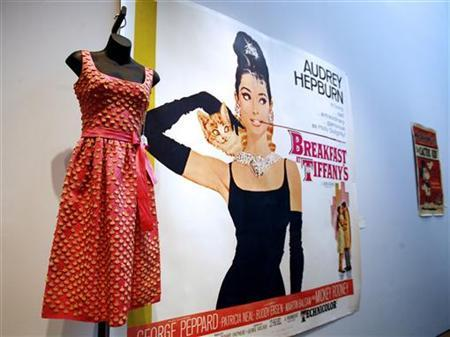 The hot pink cocktail dress worn by actress Audrey Hepburn in ''Breakfast at Tiffany's'' sits on display with other items during a preview of the auction ''Film and Entertainment Memorabilia'' at Christie's auction house in New York, May 24, 2007. REUTERS/Shannon Stapleton/Files