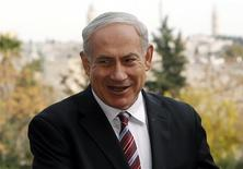 Israeli Prime Minister Benjamin Netanyahu (C) speaks during his meeting with ambassadors to Israel from Asia, in Jerusalem December 19, 2012. REUTERS/Ronen Zvulun