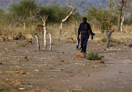 A SPLA-N fighter walks near Gos village in the rebel-held territory of the Nuba Mountains in South Kordofan, May 1, 2012. REUTERS/Goran Tomasevic