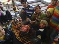 Syrian refugees fleeing violence in their towns are seen at their temporary home in a school at Tel Abyed near Hasaka December 17, 2012. REUTERS/Samer Al-Abdullah/Shaam News Network/Handout